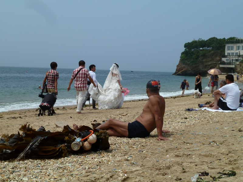 dalian bruidjes op het strand